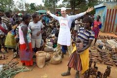 African market and italian vendor Royalty Free Stock Photos