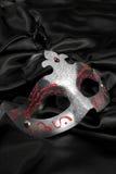 Italian Venetian mask on a black velvet Royalty Free Stock Image