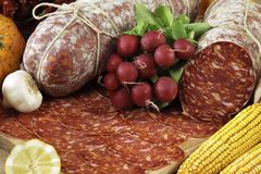 Italian ventricina salami. On cutting board Stock Photos