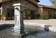 Italian villa fountain in courtyard plaza Stock Image
