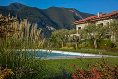 Italian villa with pool, view from the garden. royalty free stock photography