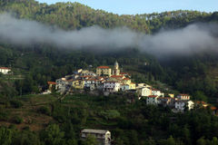 Italian Village. Fog lying over small village in Northern Italy Royalty Free Stock Photography