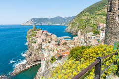 Italian village constructed on top rock outcrop jutting into Med. Colorful Italian village Vernazza constructed on top rock outcrop jutting into Mediterranean Stock Image