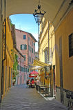 Italian village life. Lucca,Italy - July 1,2014: people are eating at an outside setting in the village of Lucca,Italy Royalty Free Stock Image