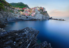 Italian village Manarola at daybreak Royalty Free Stock Images