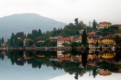 Italian village. Reflected in the lake Royalty Free Stock Images