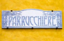 Italian vintage barber shop signboard. Close-up of italian vintage barber shop signboard Royalty Free Stock Images