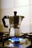 Italian vintage coffeepot on kitchen stove.  Royalty Free Stock Image