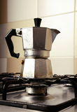 Italian vintage coffeepot on kitchen stove. Background Stock Photography