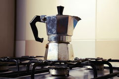 Italian vintage coffeepot on kitchen stove Royalty Free Stock Images