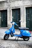 Italian vintage scooter. Italian scooter on old street Stock Photography
