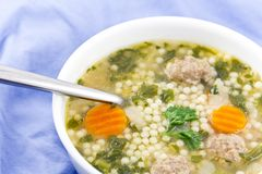 Italian Wedding Soup. With meatballs and pepe noodles Royalty Free Stock Photos