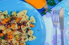 Pasta With Butternut Squash and Prosciutto. Italian Wholemeal Pasta Farfalle Butterfly Bow-tie with Butternut Squash and Prosciutto. Pasta with pumpkin sauce Royalty Free Stock Photos