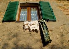 Italian window. Daily laundry in italy Royalty Free Stock Photo