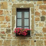 Italian window with nice flowers in old stone house, Tuscany, It royalty free stock photos