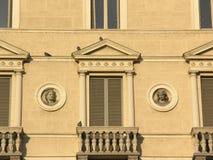 Italian windows. Fragment of neo classical Italian building royalty free stock photo