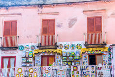 Italian windows. Colorful building and windows with ceramic plates for sale in Amalfi, Italy Stock Image