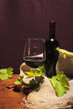 Italian wine. A bottle of red italian wine and a glass with some of it in Royalty Free Stock Images