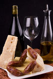 Italian wine and cheese. A view of items typical for Italian wine and cheese appetizers or reception including olive oil and meat Stock Photo