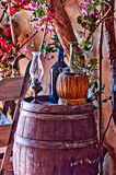 Italian winery with bottle and bottle of wine. Wine bottles, with bottle of olive oil, resting on an oak barrel cellar in a typical Italian Royalty Free Stock Photography