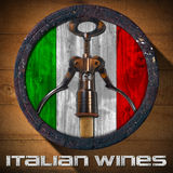 Italian Wines - Wooden Barrel. Old wooden barrel with Italian flag inside and corkscrew with cork on wooden background and metal text: Italian Wines Royalty Free Stock Photography