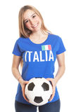 Italian woman with ball laughing at camera Royalty Free Stock Photo