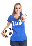 Italian woman with ball pointing at camera Stock Image
