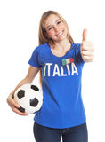 Italian woman with ball showing thumb up Royalty Free Stock Image