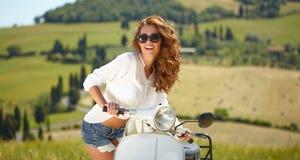 Italian woman sitting on a italian scooter Stock Image