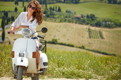 Italian woman sitting on a italian scooter Royalty Free Stock Photography