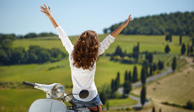 Italian woman sitting on a italian scooter Stock Images