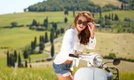 Italian woman sitting on a italian scooter Stock Photography