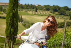 Italian woman sitting on a italian scooter Royalty Free Stock Image