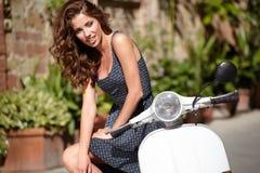 Italian woman sitting on a italian scooter Royalty Free Stock Photos