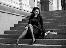 Italian woman sitting on stone steps Stock Photography