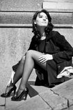 Italian woman sitting on stone steps Royalty Free Stock Image