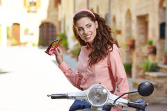 Italian woman sitting on a vintage  scooter. Stock Images
