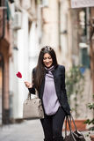 Italian Woman. A young beautiful dark hair woman with a handbag walking with intent in the beautiful narrow streets of Genoa, an old Italian harbor city stock images