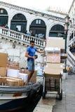 Italian worker is unloading parcels stock photos
