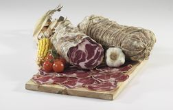 Italiancoppa di Parma salami. Italian coppa di Parma salami on cutting board Royalty Free Stock Photos