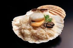 ` Italiano del risotto del ` con el trufflw y la concha de peregrino foto de archivo