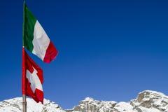 Italiano y banderas de Suiza Imagen de archivo libre de regalías
