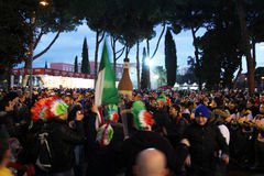 Italians irish fans. Italians and irish supporters are making a party after the rbs rugby match played at rome.7/2/2015 Royalty Free Stock Images