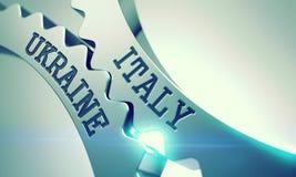 Italien Ukraina - text på mekanism av metallkugghjul 3d Arkivfoto