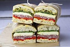 Italienare tryckte på smörgåsar Arkivbild