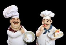 Italienische Chefs, die Nahrung kochen Stockfotos