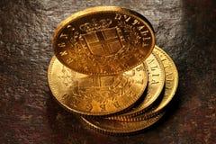 Italienische Goldmünzen stockbilder