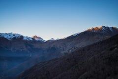 Italienischer alpiner Bogen bei Sonnenuntergang Lizenzfreies Stockbild