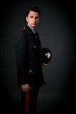 Italienischer Carabinieresohn-Grauhintergrund Stockfoto