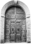 Italienisches Architekturdetail Alte mittelalterliche Arthaustür Stockfotografie